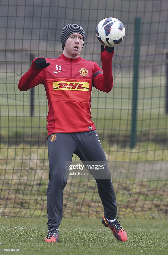 Paul Scholes of Manchester United in action during a first team training session at Carrington Training Ground on March 8, 2013 in Manchester, England.