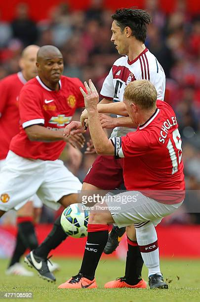 Paul Scholes of Manchester United Legends tackles Robert Kovac of Bayern Munich All Stars during the Manchester United Foundation charity match...
