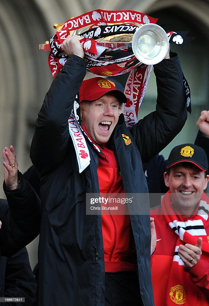Paul Scholes of Manchester United lifts the Barclays Premier League trophy during the Manchester United Premier League Winners Parade at Manchester Town Hall on May 13, 2013 in Manchester, England.