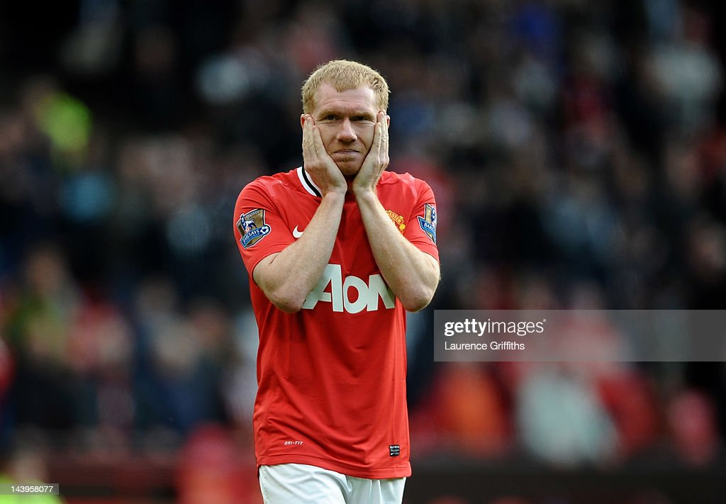 Paul Scholes of Manchester United looks dejected at the end of the Barclays Premier League match between Manchester United and Swansea City at Old Trafford on 6 May 2012 in Manchester, England.