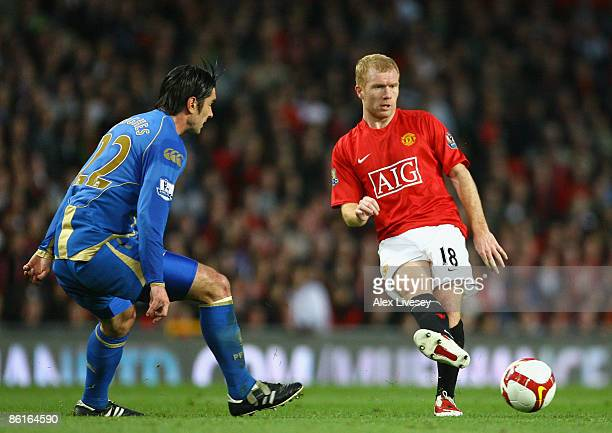 Paul Scholes of Manchester United passes the ball on his 600th appearance for United during the Barclays Premier League match between Manchester...