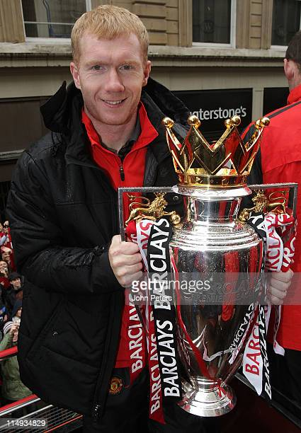 Paul Scholes of Manchester United poses with the Barclays Premier League trophy during the Manchester United Premier League Winners Parade on May 30...