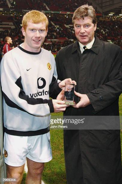 Paul Scholes of Manchester United receives his PFA Fans' Player of the Month award for January from Martin Buchan ahead of the FA Premiership match...