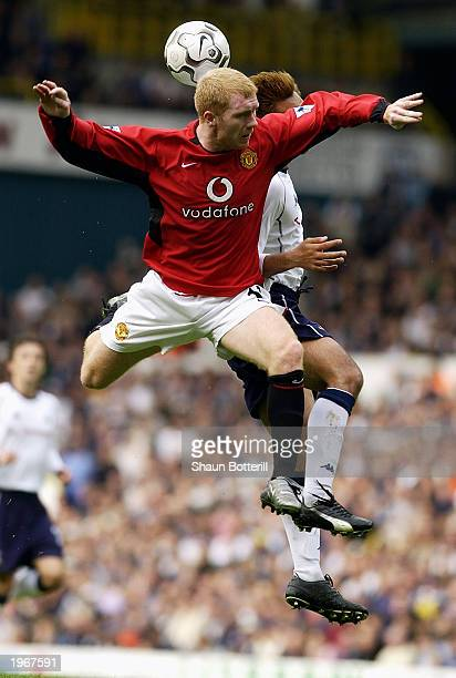 Paul Scholes of Manchester United rises above Kazuyuki Toda of Tottenham Hotspur during the FA Barclaycard Premiership match held on April 27 2003 at...