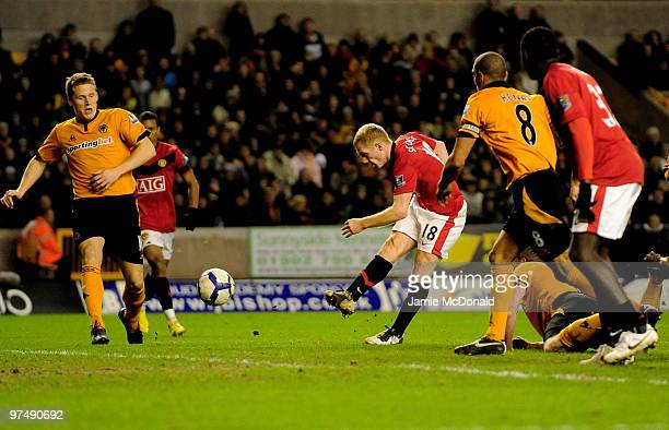 Paul Scholes of Manchester United scores his goal during the Barclays Premier League match between Wolverhampton Wanderers and Manchester United at...