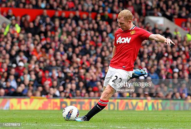 Paul Scholes of Manchester United scores his team's second goal during the Barclays Premier League match between Manchester United and Queens Park...