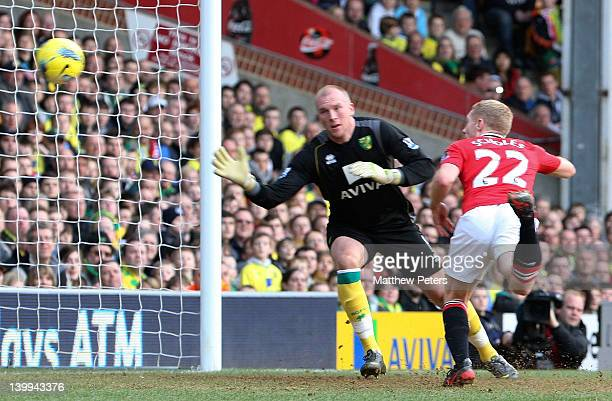 Paul Scholes of Manchester United scores their first goal during the Barclays Premier League match between Norwich City and Manchester United at...