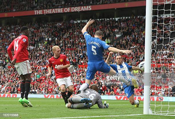 Paul Scholes of Manchester United scores their first goal during the Barclays Premier League match between Manchester United and Wigan Athletic at...