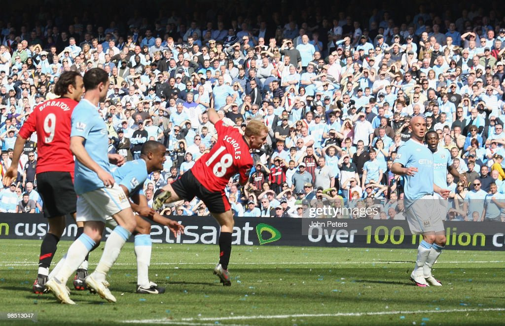 Paul Scholes of Manchester United scores their first goal during the Barclays Premier League match between Manchester City and Manchester United at City of Manchester Stadium on April 17 2010 in Manchester, England.