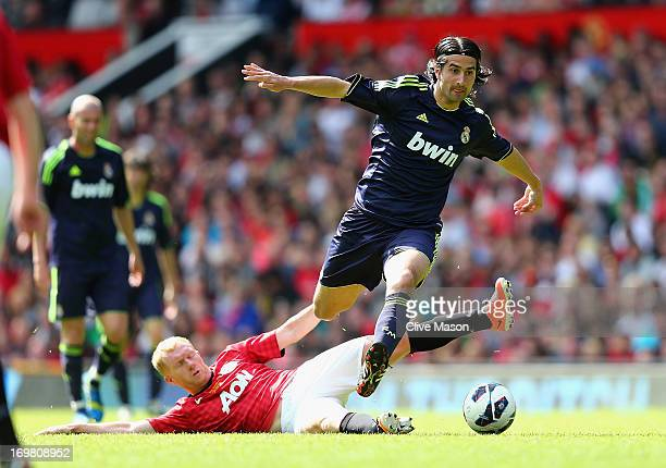 Paul Scholes of Manchester United slide tackles Ruben De La Red of Real Madrid during the charity match between Manchester United Legends and Real...