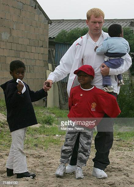 Paul Scholes of Manchester United visits the Baphumela Home orphanage in Capetown as part of their preseason tour of South Africa on July 17 2006 in...