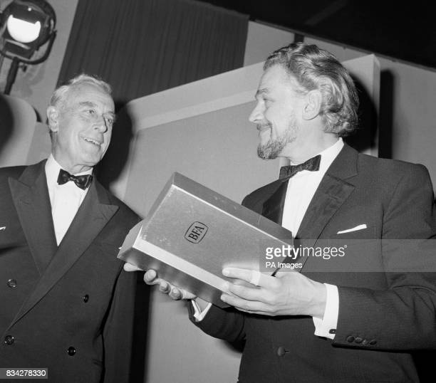 Paul Scofield talks with Earl Mountbatten after receiving his British Film Academy Award as Best British Actor at the Hilton Hotel London He was...