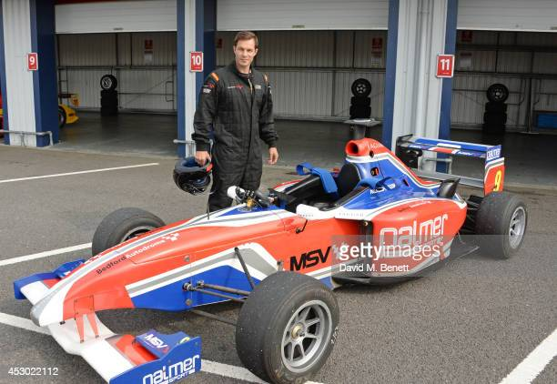 Paul Sculfor prepares to drive at the Stride Foundation track day in aid of The Amy Winehouse Foundation at the Bedford Autodrome on August 1 2014 in...