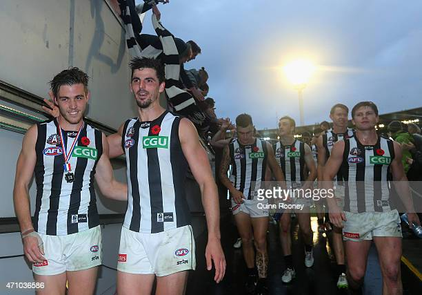 Paul Seedsman and Scott Pendlebury of the Magpies celebrate winning the round four AFL match between the Essendon Bombers and the Collingwood Magpies...