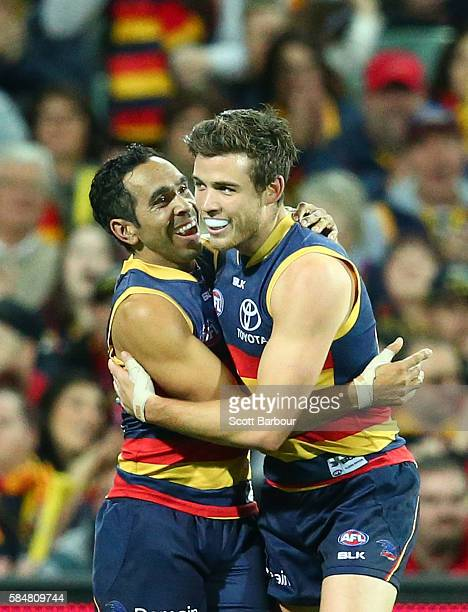Paul Seedsman of the Crows celebrates with Eddie Betts of the Crows after kicking a goal during the round 19 AFL match between the Adelaide Crows and...