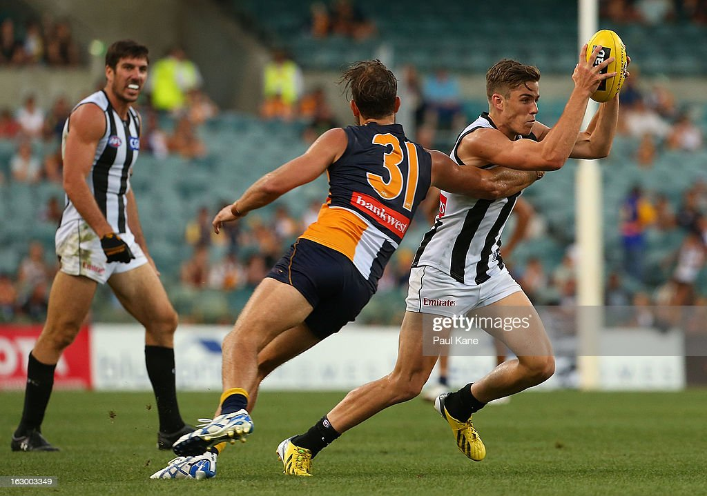Paul Seedsman of the Magpies looks to evade a tackle by Will Schofield of the Eagles during the round two AFL NAB Cup match between the West Coast Eagles and the Collingwood Magpies at Patersons Stadium on March 3, 2013 in Perth, Australia.