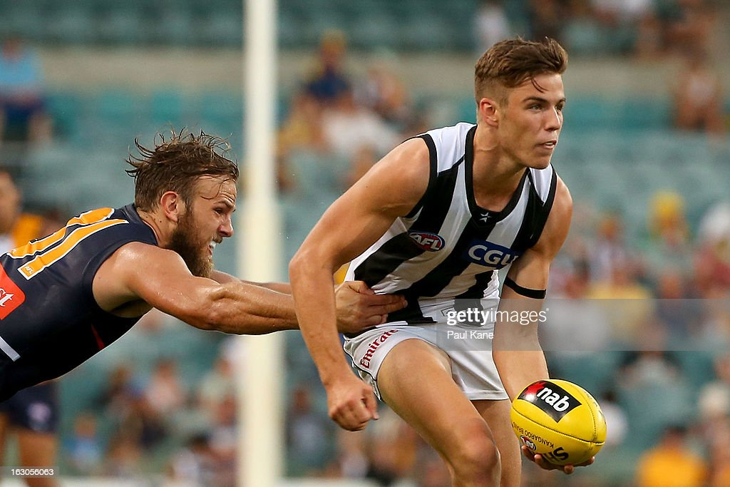 Paul Seedsman of the Magpies looks to handball while being tackled by Will Schofield of the Eagles during the round two AFL NAB Cup match between the West Coast Eagles and the Collingwood Magpies at Patersons Stadium on March 3, 2013 in Perth, Australia.