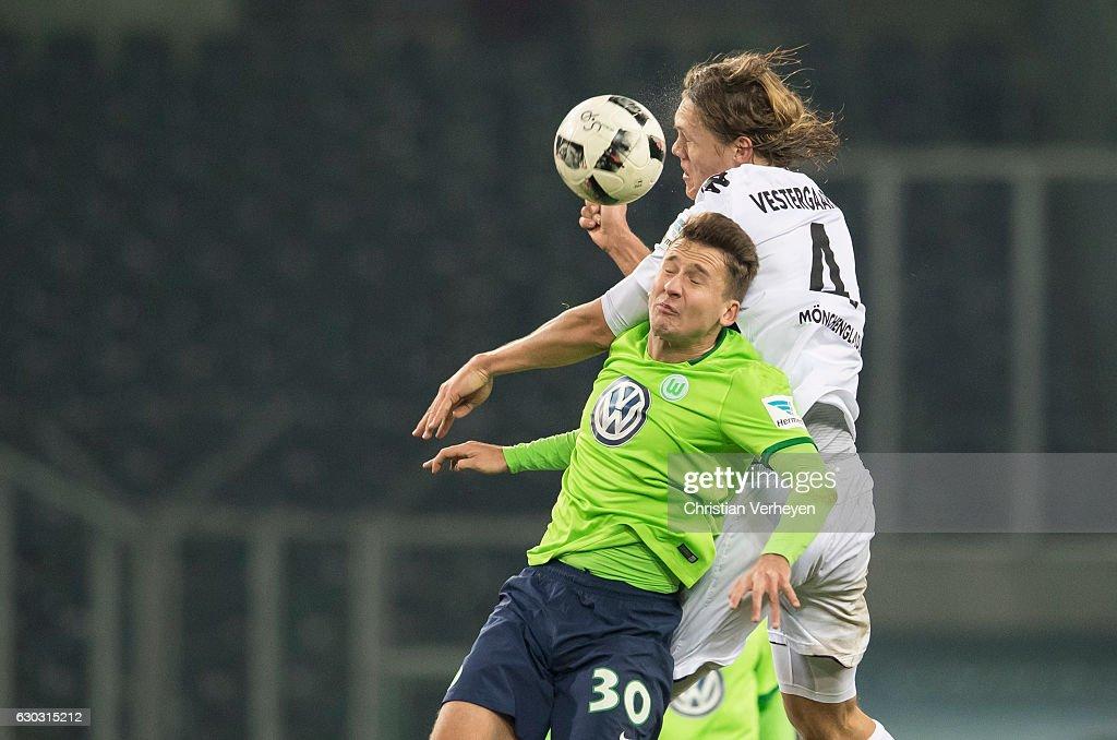 Paul Seguin of VfL Wolfsburg and Jannik Vestergaard of Borussia Moenchengladbach battle for the ball during the Bundesliga match between Borussia Moenchengladbach and VfL Wolfsburg at Borussia-Park on December 20, 2016 in Moenchengladbach, Germany.