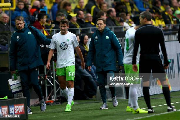 Paul Seguin of Wolfsburg walks off the pitch injured during the Bundesliga match between Borussia Dortmund and VfL Wolfsburg at Signal Iduna Park on...