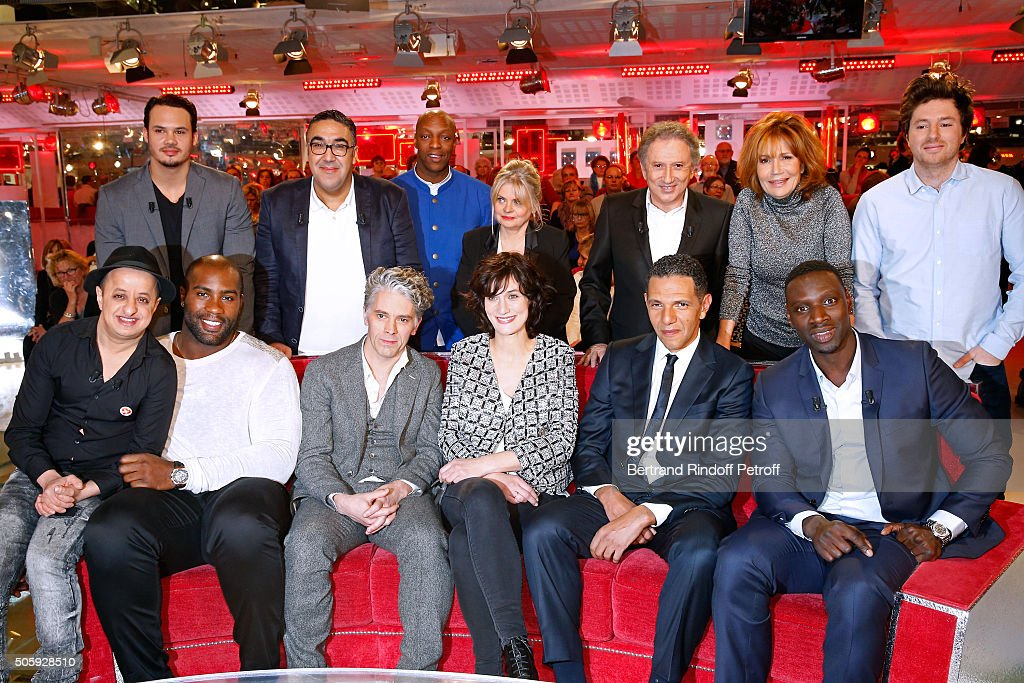 Paul Sere, Wahid Bouzidi, Oxmo Puccino, Isabelle Nanty, Michel Drucker, Clementine Celarie, Jean Imbert, (Front L-R) Booder, Teddy Riner, James Thierree, Clotilde Hesme, Roschdy Zem and Main guest of the show, Actor Omar Sy attend the 'Vivement Dimanche' French TV Show at Pavillon Gabriel on January 20, 2016 in Paris, France.