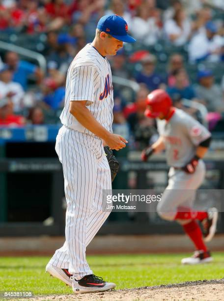Paul Sewald of the New York Mets stands on the mound after surrendering a seventhinning threerun home run against Zack Cozart of the Cincinnati Reds...
