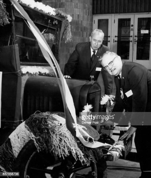 Paul Shaver Right Retiring MidContinent Eagles President Cranks Uo Rex Plyer of Ogden Utah new regional president looks on as 1916 Model T Ford gelo...