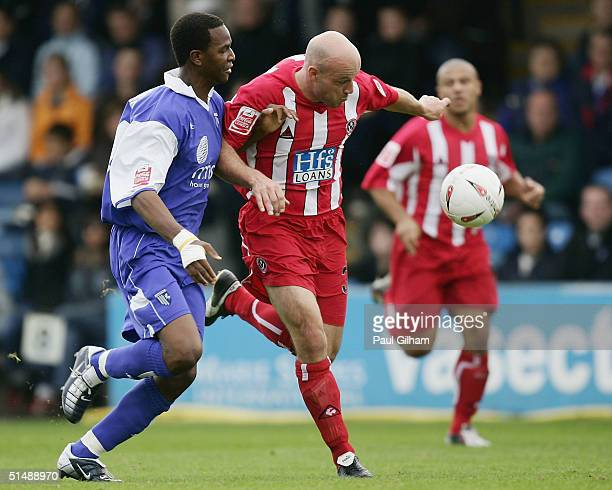 Paul Shaw of Sheffield United battles for the ball with Leon Johnson of Gillingham during the CocaCola Championship match between Gillingham and...