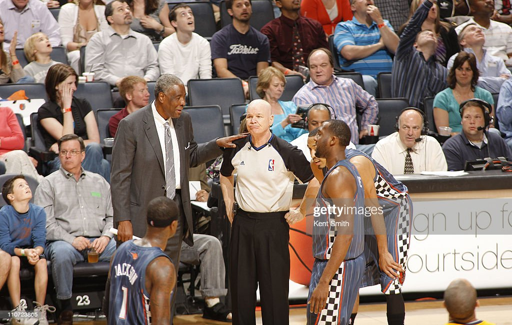 Paul Silas, head coach of the Charlotte Bobcats, questions official Joe Crawford about a call during the game against the Indiana Pacers on March 23, 2011 at Time Warner Cable Arena in Charlotte, North Carolina.