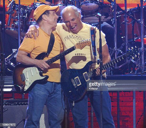 Paul Simon and Jimmy Buffett during From the Big Apple to the Big Easy Madison Square Garden Show at Madison Square Garden in New York City New York...