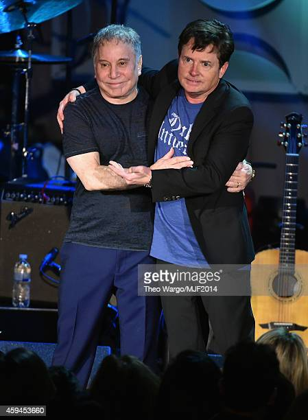 Paul Simon and Michael J Fox perform onstage during the 2014 A Funny Thing Happened On The Way To Cure Parkinson's at The Waldorf=Astoria on November...