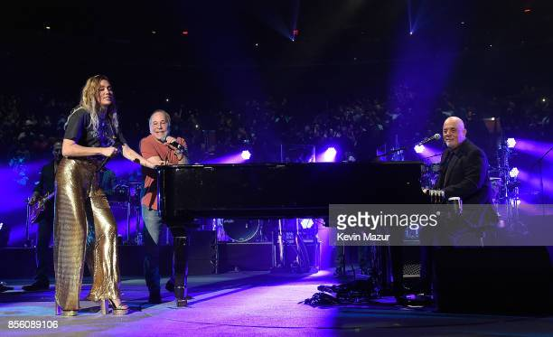 Paul Simon Miley Cyrus and Billy Joel perform at Madison Square Garden on September 30 2017 in New York City