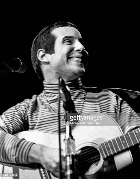 Paul Simon of Simon and Garfunkel performs on stage at the Monterey Pop Festival on June 16 1967 in Monterey California