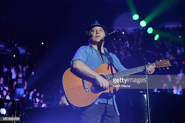 Paul Simon performs as a surprise guest during the final show at Nassau Coliseum on August 4 2015 in Long Island New York