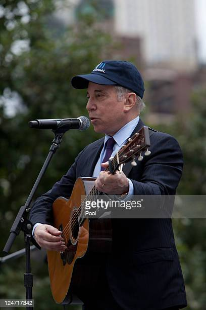 Paul Simon performs at the 9/11 Memorial during the tenth anniversary ceremonies of the September 11 2001 terrorist attacks at the World Trade Center...