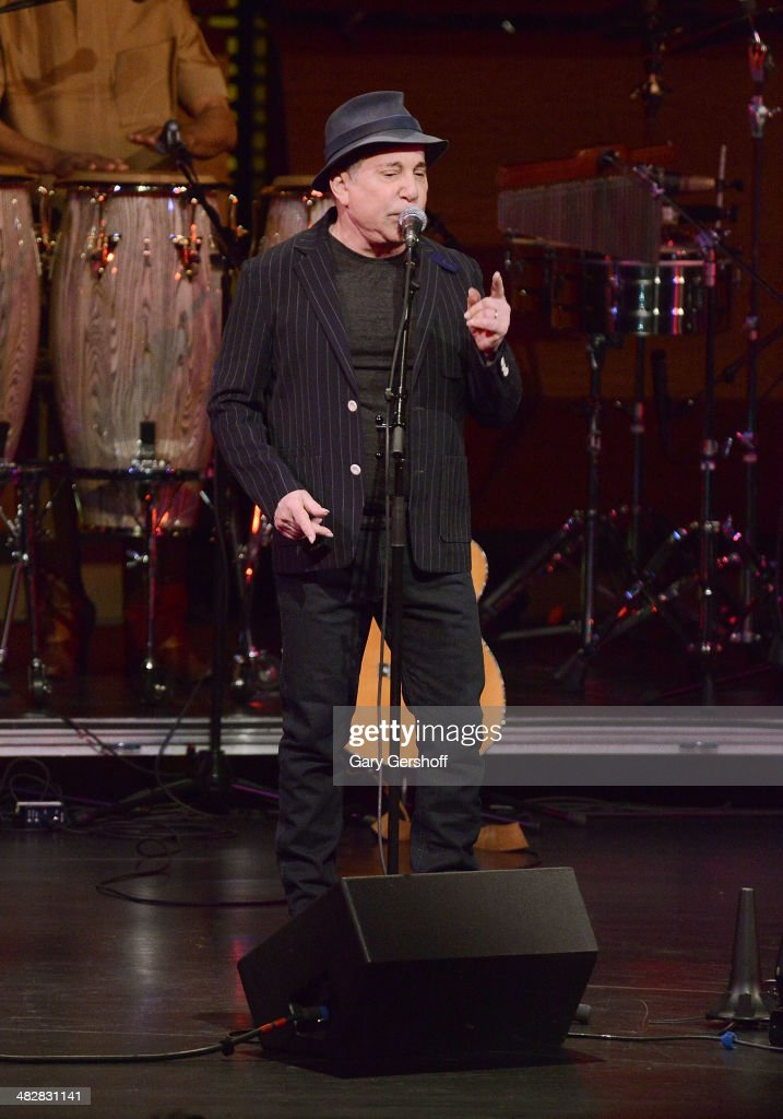 <a gi-track='captionPersonalityLinkClicked' href=/galleries/search?phrase=Paul+Simon+-+Musician&family=editorial&specificpeople=204186 ng-click='$event.stopPropagation()'>Paul Simon</a> performs during the Hugh Masekela: Celebrating 75 Years concert at Rose Theater, Jazz at Lincoln Center on April 4, 2014 in New York City.