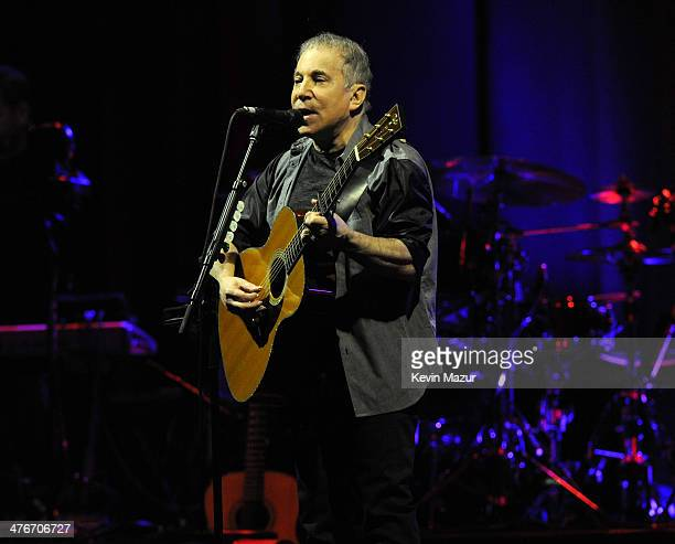 Paul Simon performs on stage during the Sting Paul Simon 'On Stage Together' tour at Madison Square Garden on March 4 2014 in New York New York