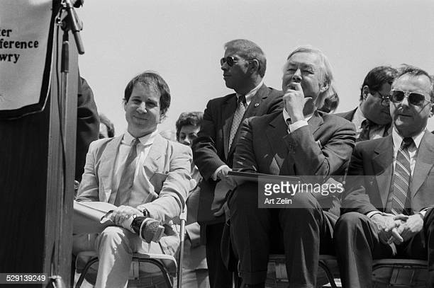 Paul Simon seated on a dais with Daniel Patrick Moynihan circa 1970 New York