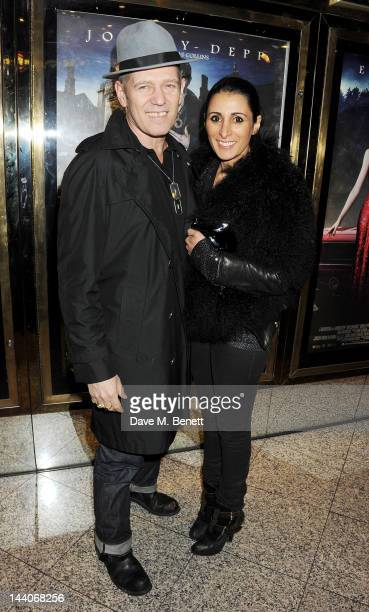 Paul Simonon and Serena Rees attend the European Premiere of 'Dark Shadows' at Empire Leicester Square on May 9 2012 in London England