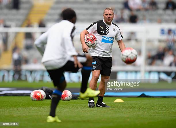 Paul Simpson coach of Newcastle United oversees the warm up prior to the Barclays Premier League match between Newcastle United and Southampton at St...