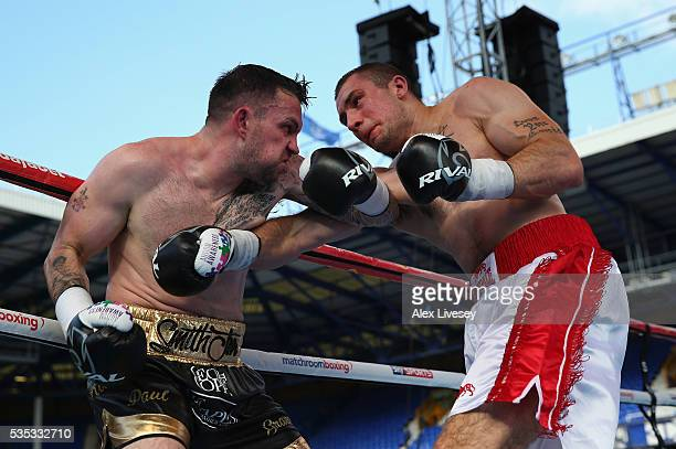 Paul Smith and Bartlomiej Grafka trade punches during the SuperMiddleweight Contest between Paul Smith and Bartlomiej Grafka at Goodison Park on May...