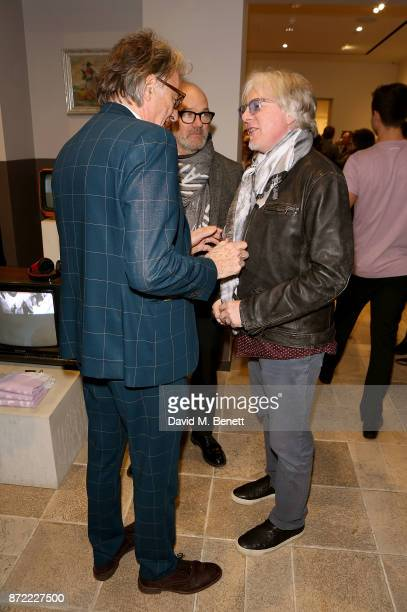 Paul Smith Michael Stipe and Mike Mills attend the launch of the Paul Smith x REM collection celebrating the 25th anniversary of REM's album...