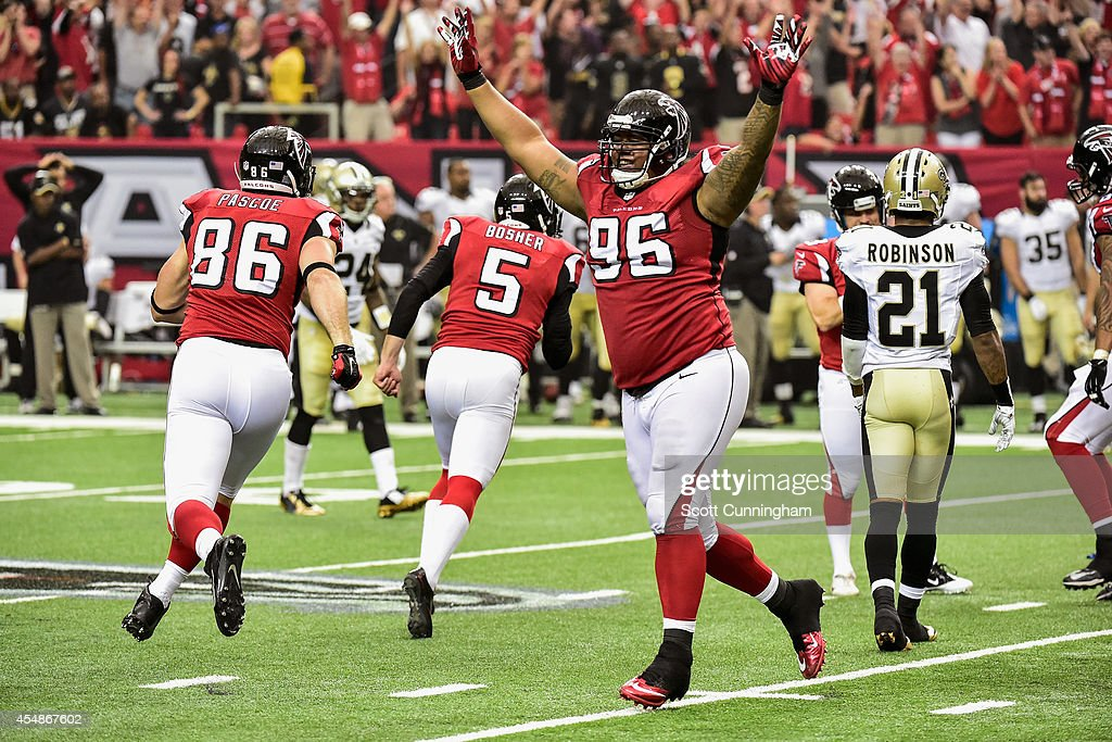 Paul Soliai of the Atlanta Falcons celebrates after beating the New Orleans Saints in overtime at the Georgia Dome on September 7 2014 in Atlanta...