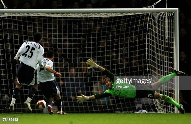 Paul Stalteri of Tottenham scores the matchwinning goal past the outstretched Robert Green of West Ham during the Barclays Premiership match between...
