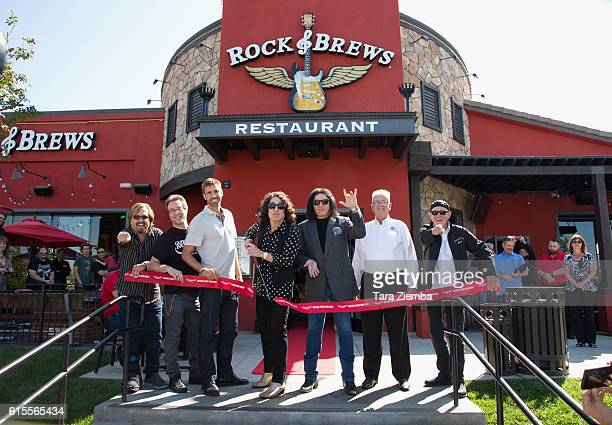 Paul Stanley and Gene Simmons cut the ribbon for the official grand opening of Rock Brews on October 18 2016 in Corona California