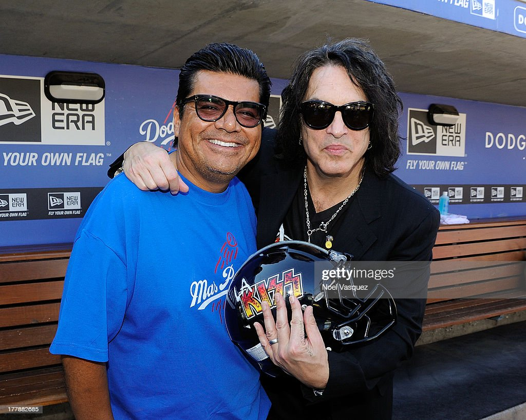 Paul Stanley (R) and <a gi-track='captionPersonalityLinkClicked' href=/galleries/search?phrase=George+Lopez&family=editorial&specificpeople=202546 ng-click='$event.stopPropagation()'>George Lopez</a> attend a baseball game between the Boston Red Sox and the Los Angeles Dodgers at Dodger Stadium on August 25, 2013 in Los Angeles, California.