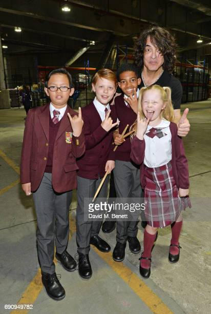 Paul Stanley of KISS poses with School Of Rock The Musical' cast members Cole Lam Toby Lee Bailey Cassell and Eliza Cowdery backstage at The O2 Arena...