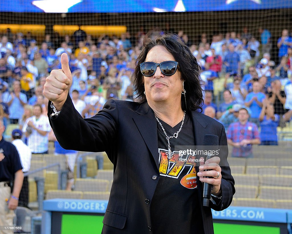 Paul Stanley sings the national anthem at a baseball game between the Boston Red Sox and the Los Angeles Dodgers at Dodger Stadium on August 25, 2013 in Los Angeles, California.