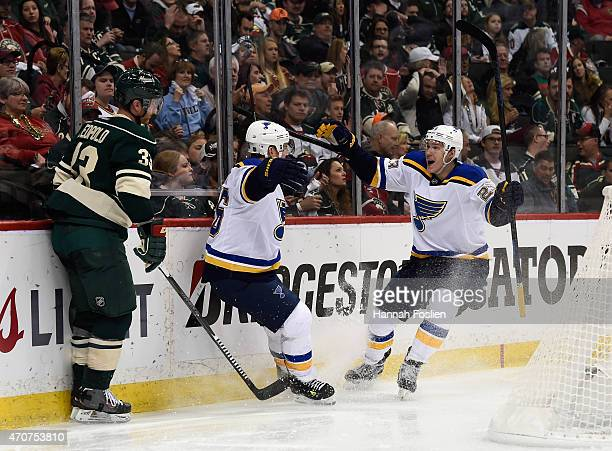 Paul Stastny and Dmitrij Jaskin of the St Louis Blues celebrate a goal by Stastny as Jordan Leopold of the Minnesota Wild looks on during the second...