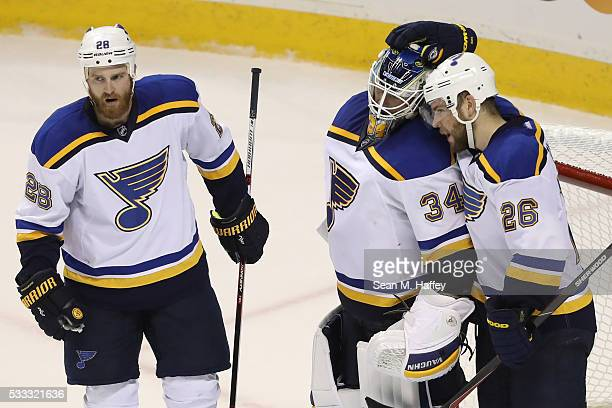 Paul Stastny and Kyle Brodziak celebrate with Jake Allen of the St Louis Blues after their 63 win in game four over the San Jose Sharks in the...