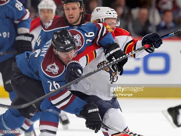 Paul Stastny of the Colorado Avalanche and Kris Versteeg of the Florida Panthers battle for position at the Pepsi Center on January 18 2012 in Denver...